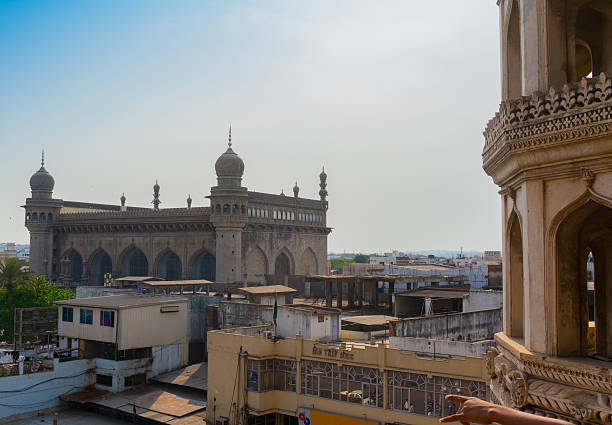 View of Makkah Mosque from charminar hyderabad Hyderabad, Telangana, India, 28th Feb 2016: View of the Makkah masjid mosque from Charminar in Hyderabad. This is a famous landmark in the old city char minar stock pictures, royalty-free photos & images