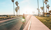 Person bicycling into sunset in San Diego, California.