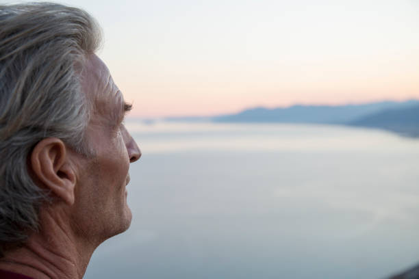 View of man looking off across the Mediterranean Sea stock photo