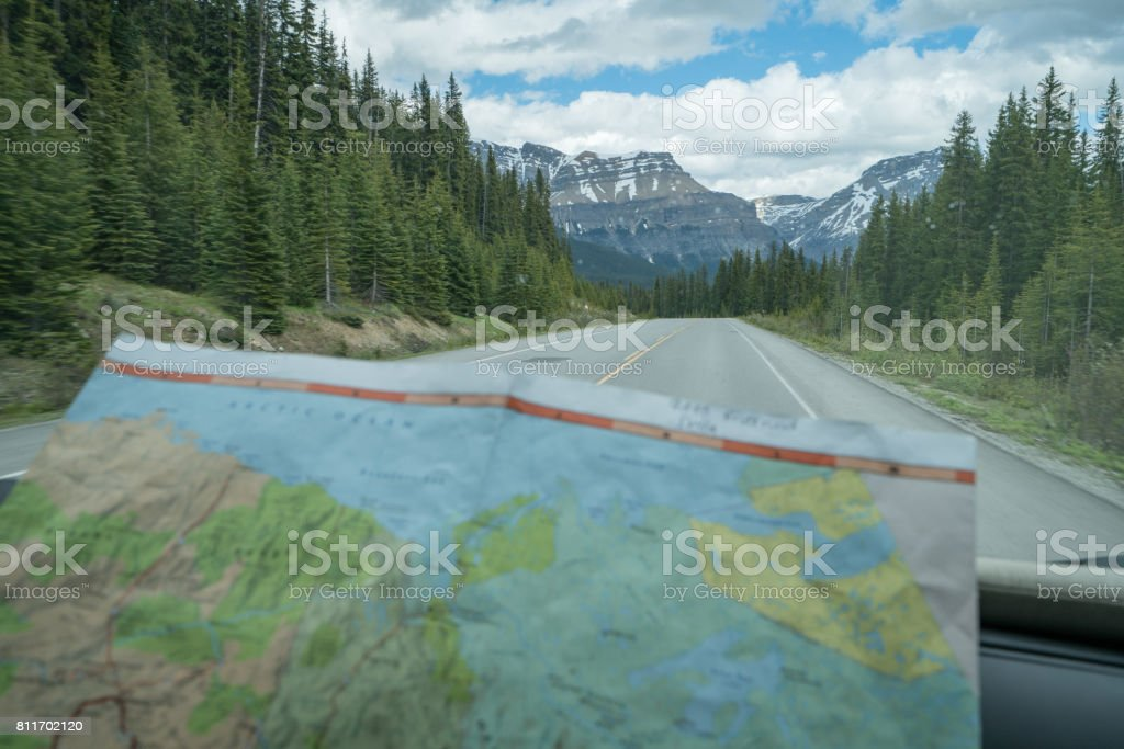 View of map inside vehicle, mountain road stock photo