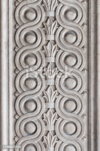 View of Massa, Italy. Ornamental bas-relief in marble on the cathedral's entrance portal.