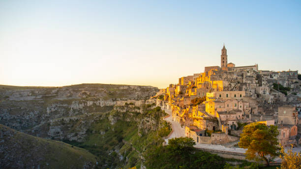 View of Matera at sunrise, Basilicata, Italy Matera, European Capitals of Culture 2019 matera italy stock pictures, royalty-free photos & images