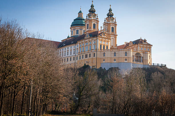 View of Melk Abbey Austria From Below Morning Melk Abbey sits on a bluff above the town of Melk, Austria.  This image was taken in the morning in December. abbey monastery stock pictures, royalty-free photos & images