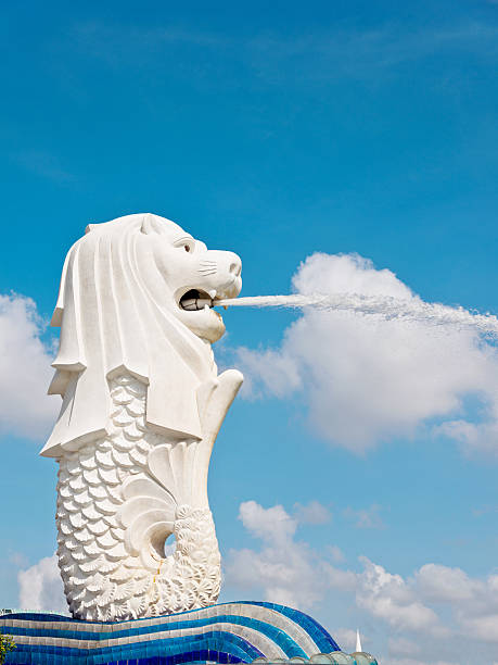 View of Merlion fountain in Singapore Singapore City, Singapore - January 9, 2016: Merilon Statue at Marina Bay. It is a popular tourist destination. merlion statue stock pictures, royalty-free photos & images
