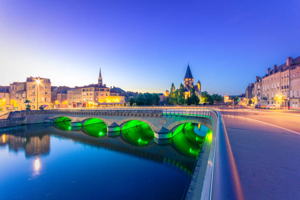 View of Metz with Temple Neuf reflected in the Moselle River, Lorraine, France View of Metz with Temple Neuf reflected in the Moselle River, Lorraine, France grand est stock pictures, royalty-free photos & images