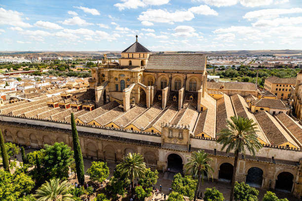 View of Mezquita, Catedral de Cordoba, from the Bell tower, the former Minaret of the Moorish mosque. Cordoba, Andalucia, South of Spain. The cathedral is a UNESCO world heritage site. View of Mezquita, Catedral de Cordoba, from the Bell tower, the former Minaret of the Moorish mosque. Cordoba, Andalucia, South of Spain. The cathedral is a UNESCO world heritage site. cordoba mosque stock pictures, royalty-free photos & images