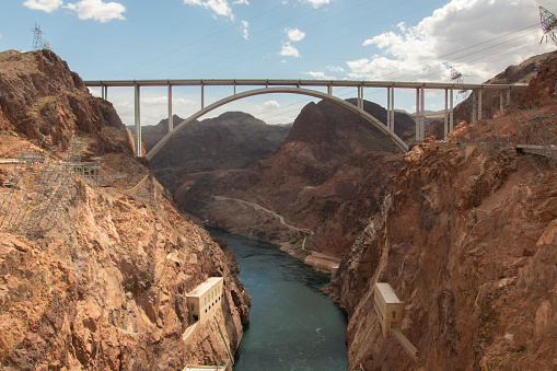 How does one get from one side of a river to the other? How does one get from one side of the Colorado River to the other? Well, the same way as any other river - swim, or run so fast that you run along the surface of the water. Or build a bridge, and get over it.