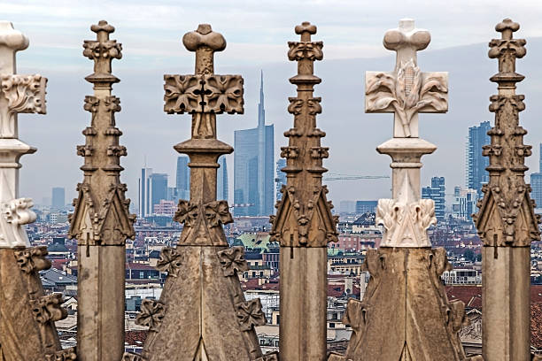 view of milano financial district and statues of milan cthedral - torenspits stockfoto's en -beelden