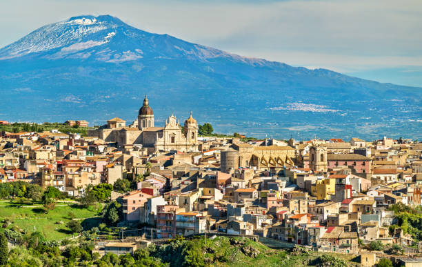 View of Militello in Val di Catania with Mount Etna in the background - Sicily, Italy View of Militello in Val di Catania with Mount Etna in the background - Sicily, Southern Italy catania stock pictures, royalty-free photos & images