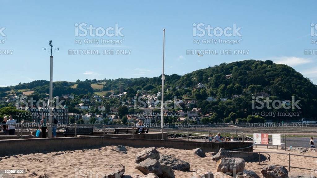 View of Minehead Somerset England UK beach and seafront towards the harbour and view of the North Hill mountain. stock photo