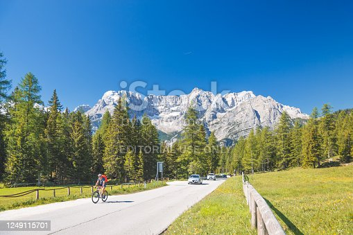 Misurina , Italy - 11 June  2017 ; View of Misurina in the Dolomites. Famaus tourist attraction with a huge mountain behind it in the early morning. Cadore. Veneto. Italy.