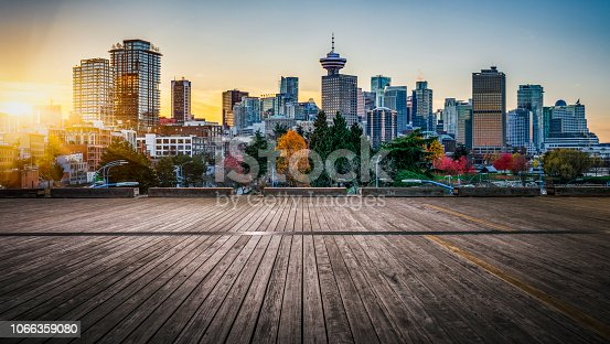 empty wooden plank front of city skyline,vancouver,canada.