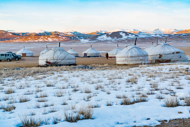 view of mongolian ger on the snowy steppe in the morning - altai nature reserve стоковые фото и изображения