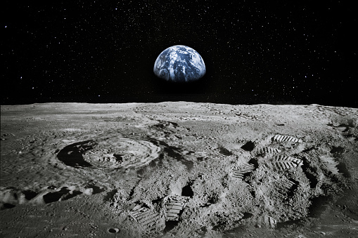 View of Moon limb with Earth rising on the horizon. Footprints as an evidence of people being there or great forgery. Collage. Elements of this image furnished by NASA.\n\n/urls:\nhttps://images-assets.nasa.gov/image/as11-44-6551/as11-44-6551~orig.jpg\nhttps://images.nasa.gov/details-as11-44-6551.html\nhttps://images.nasa.gov/details-as17-145-22285.html\nhttps://images.nasa.gov/details-as11-40-5964.html\nhttps://solarsystem.nasa.gov/resources/429/perseids-meteor-2016/