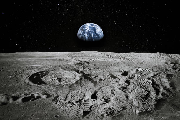 view of moon limb with earth rising on the horizon. footprints as an evidence of people being there or great forgery. collage. elements of this image furnished by nasa. - przestrzeń kosmiczna zdjęcia i obrazy z banku zdjęć
