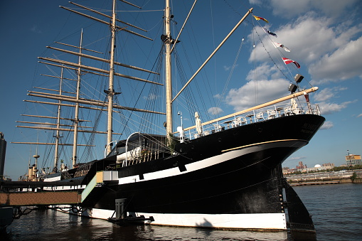 View of Moshulu Sailing Ship with bar and restaurant on deck at Penn's Landing Marina and Delaware River Waterfront in Philadelphia, Pennsylvania, USA