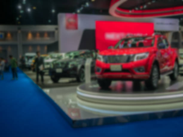 view of motor show exhibition blurred background view of motor show exhibition blurred background car show stock pictures, royalty-free photos & images