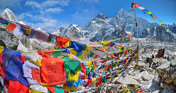 View of Mount Everest and Nuptse  with buddhist prayer flags stock photo