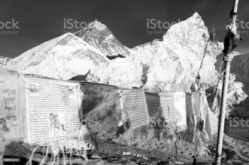 view of Mount Everest with buddhist prayer flags stock photo