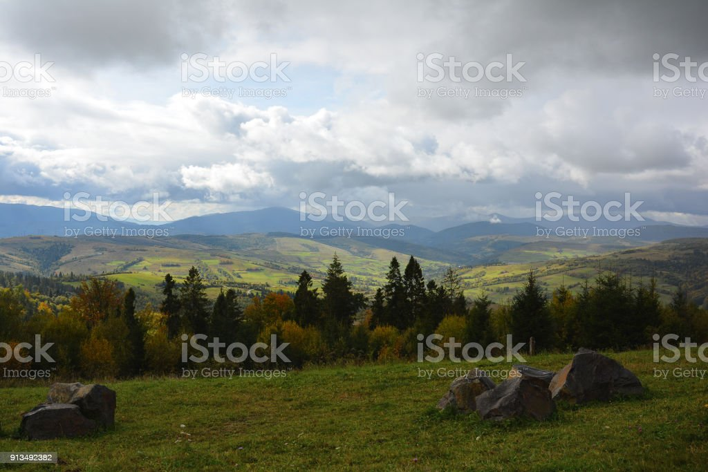 View of mountains and valley from Veretskyi Pass in autumn day before rain. stock photo