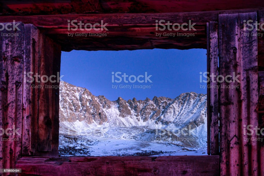 View of Mountains Through Abandoned Building Window stock photo
