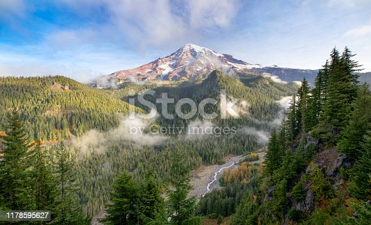 View of Mt. Rainier and the Nisqually River from the Ricksecker Point Scenic Lookout as autumn is beginning to show some colors