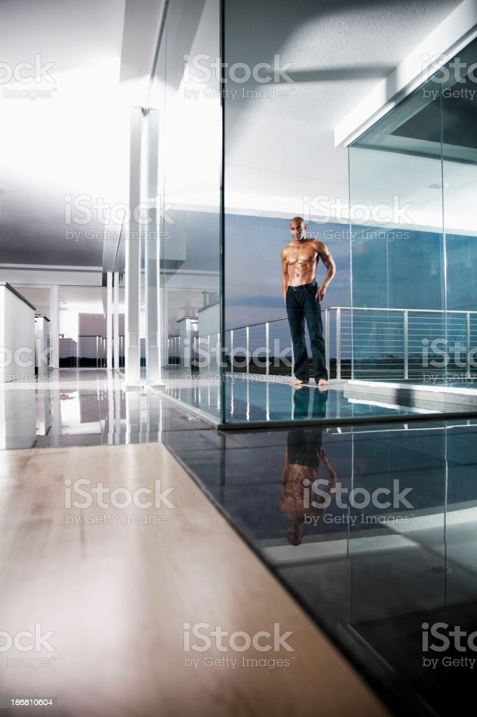 View of muscular African American man by pool royalty-free stock photo
