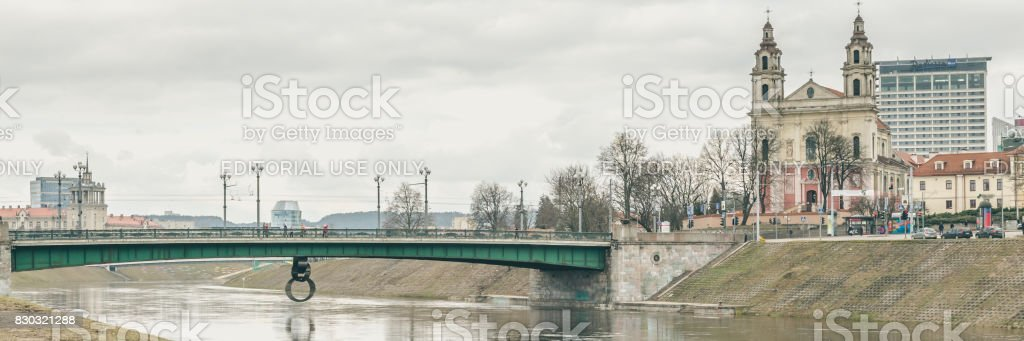 Vilnius, Lithuania - March, 12, 2017: View of Neris river with Green bridge and the Church of the St Raphael the Archangel, Vilnius, Lithuania. stock photo