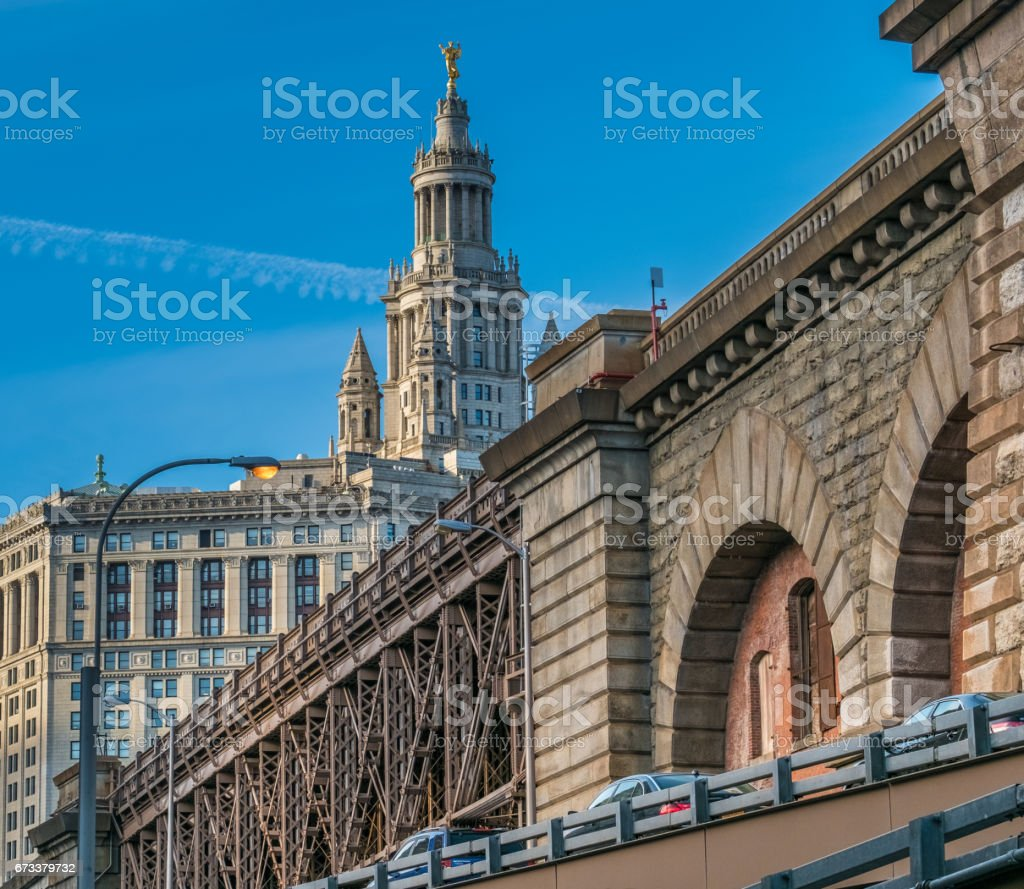 View of New York City's City Hall from the base of the Brooklyn Bridge, NYC stock photo