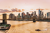 View of New York Skyline and Brooklyn Bridge during sunset