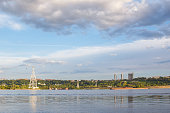 View of Nizhny Novgorod in the area of the cable car through the Volga in the summer evening at sunset
