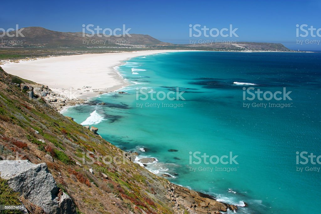 View of Noordhoek Beach from Chapmans Peak Drive on the Cape Peninsula near Cape Town, South Africa stock photo