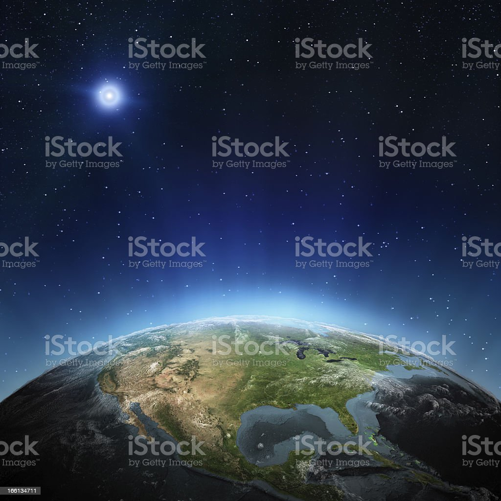 View of North America from space with moon in background stock photo