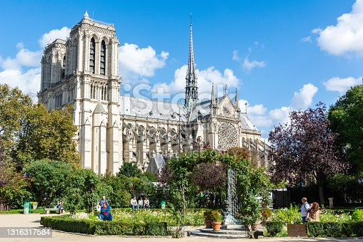 istock View of Notre-Dame de Paris cathedral from Square Rene Viviani in Paris 1316317584