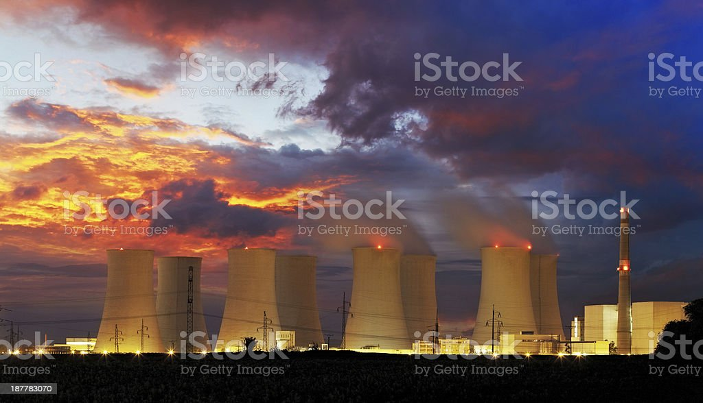 View of nuclear power plant at night stock photo