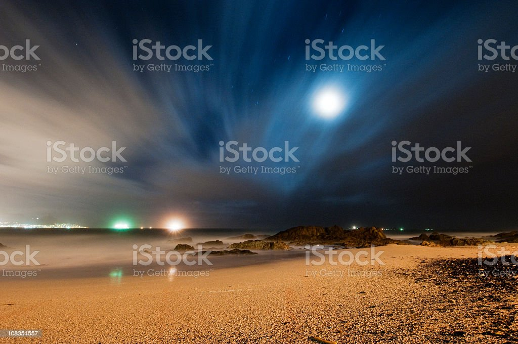 View of ocean and moon stock photo