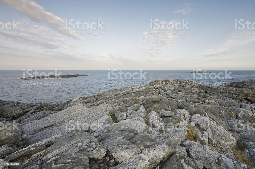 View of ocean from rocky shores at dawn in Norway royalty-free stock photo