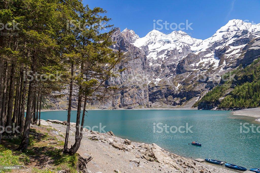 View of Oeschinensee lake with Bluemlisalp and Frundenhorn alps, Switzerland stock photo