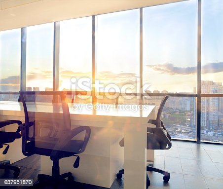 istock View of office conference room with sunset light in windows 637951870