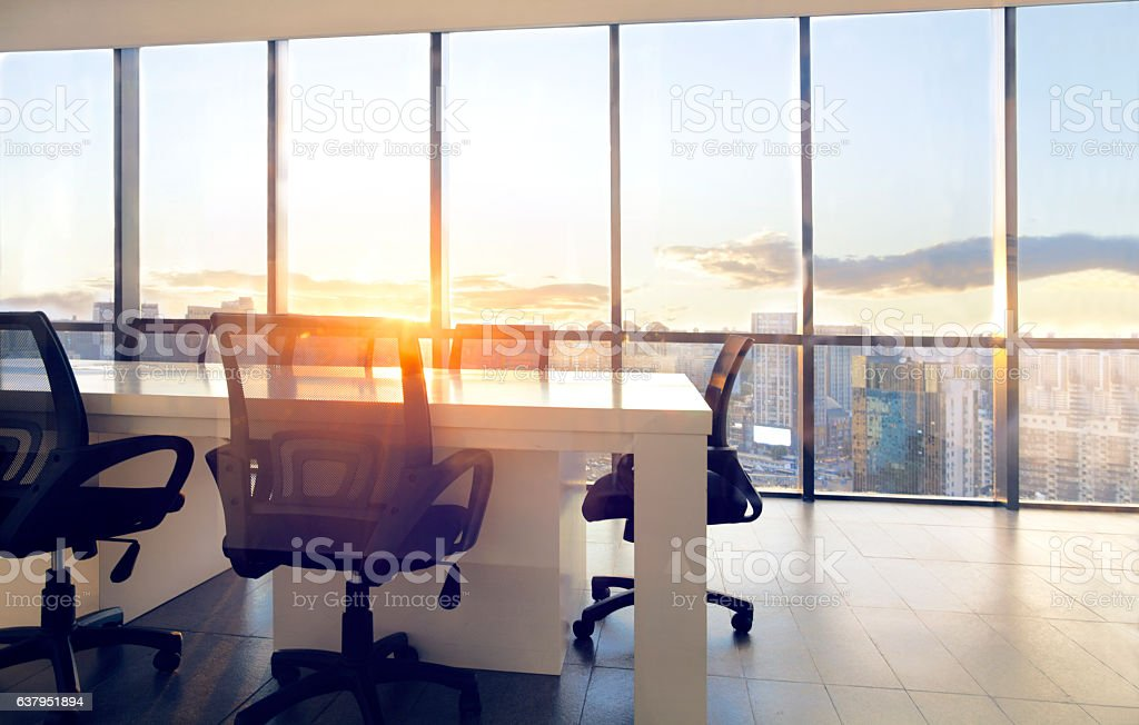 View of office conference room with sunset light in windows - foto stock