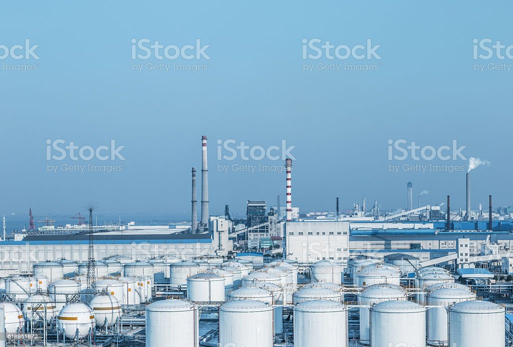 view of oil depot with chimneys stock photo