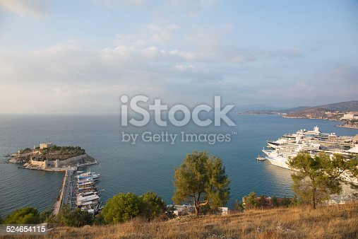 View of old fortress and line of cruise ships, Kusadasi