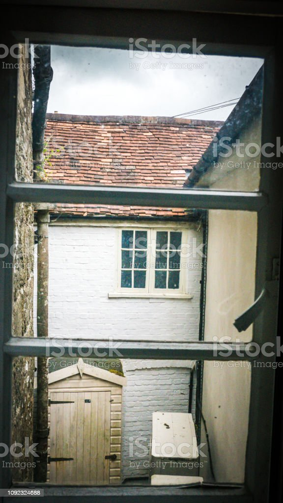 View Of Old Houses In Shaftesbury Uk With Flowers Stock