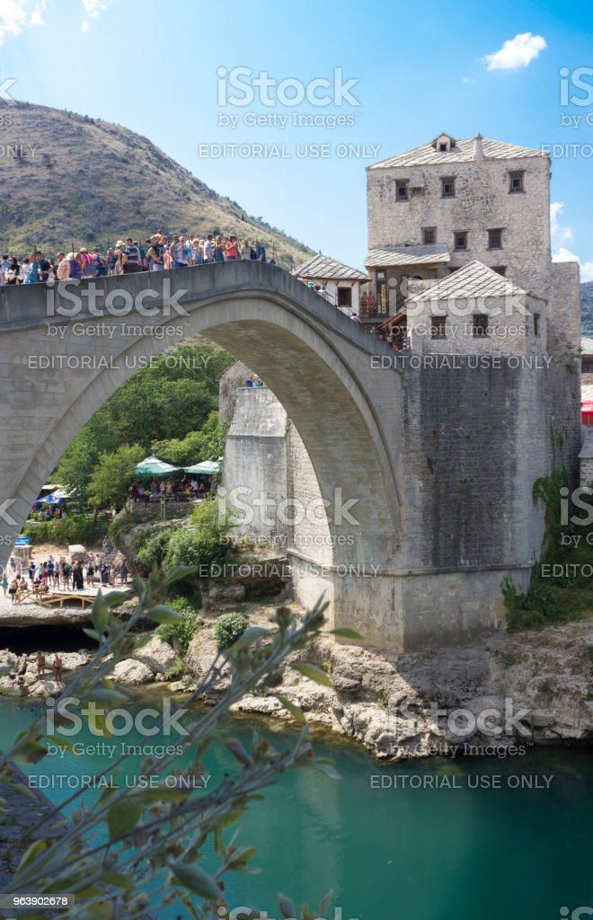 View of old Mostar bridge full of people in summer season - Royalty-free Ancient Stock Photo