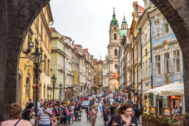 View of old town in Prague taken from Charles bridge This pic shows the colorful old town of prague. The pic is taken from the charles bridge and the view is full of tourists. tyn church stock pictures, royalty-free photos & images