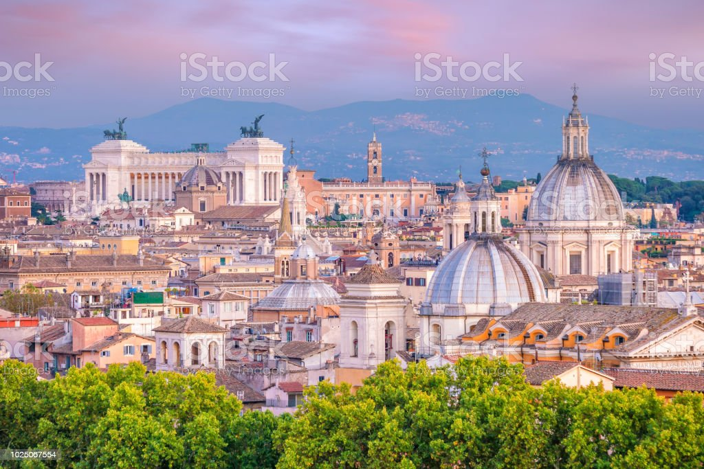 View of old town Rome skyline from Castel Sant\'Angelo, Italy at sunset