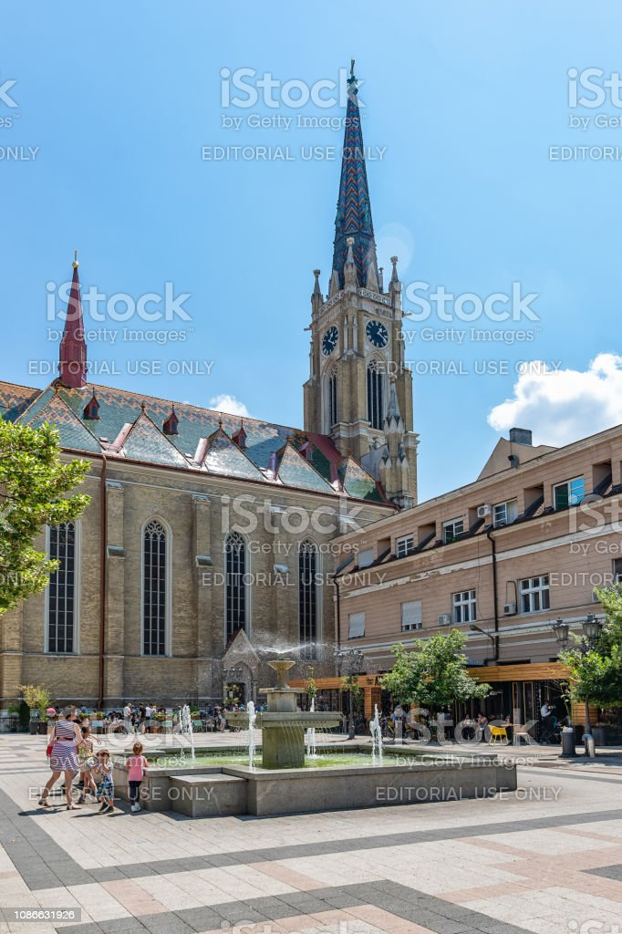 View of one square with fountain and old buildings located behind at the Catholic Church 'The Name of Mary Church' stock photo