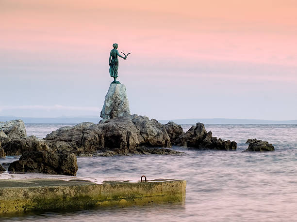 View of Opatija statue from the beach  stock photo