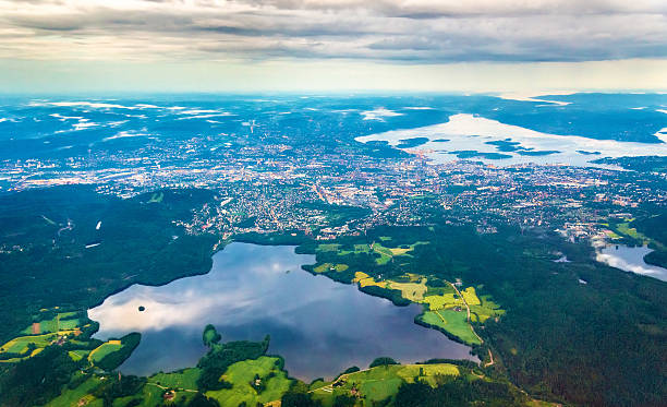 View of Oslo from an airplane on the approach to View of Oslo from an airplane on the approach to Gardermoen Airport - Norway oslo stock pictures, royalty-free photos & images