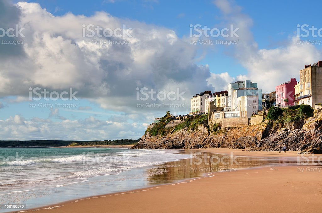 View of painted houses at Tenby,from Castle Beach. stock photo